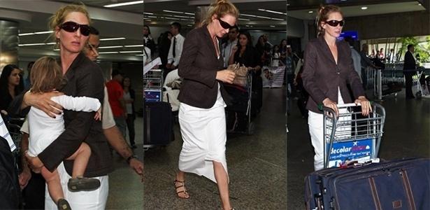 25.out.2013 - Uma Thurman desembarca no aeroporto de Guarulhos, em São Paulo, com a filha Luna