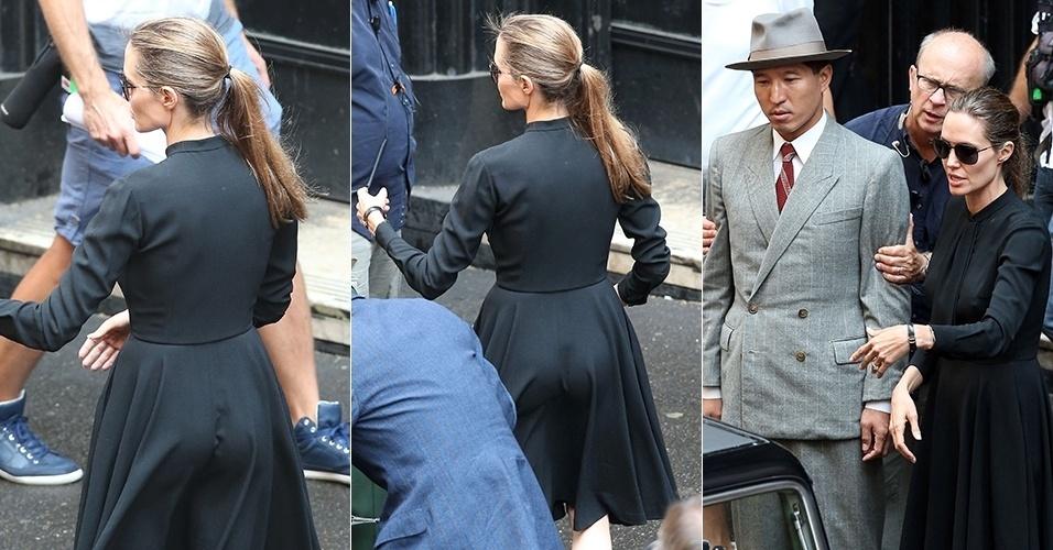 21.nov.2013 - Bumbum de Angelina Jolie fica em evidência no set de filmagens do longa