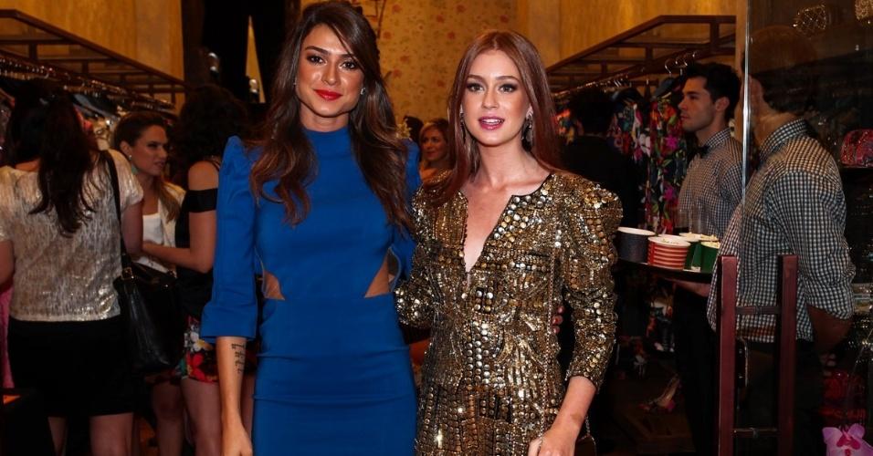 3.dez.2013 - Thaila Ayala e Marina Ruy Barbosa prestigiam inauguração de loja em São Paulo