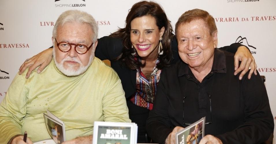 10.dez.2013- Narcisa Tamborindeguy com Ricardo Amaral e Boni