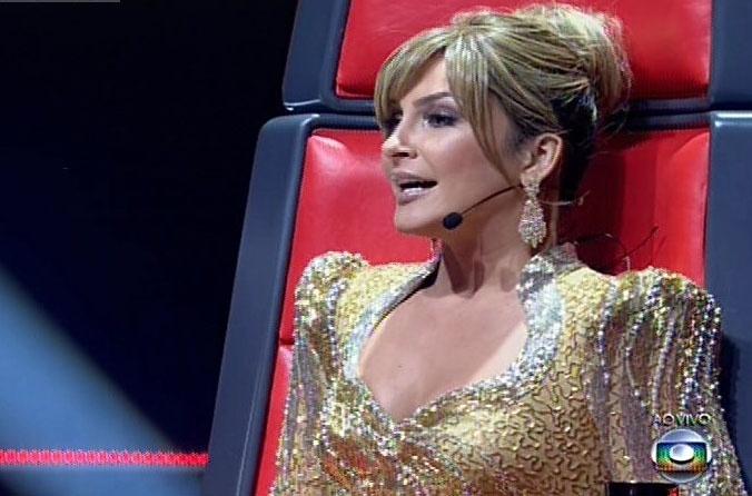 26.dez.13 -  Claudia Leitte fala por que acha que Sam Alves, de seu time, deve vencer o programa