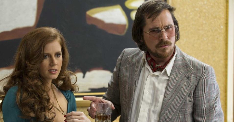 """Christian Bale em cena de """"Trapaça"""""""