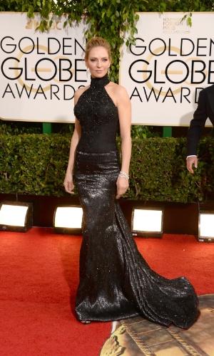 12.jan.2014 - A atriz Uma Thurman chega para a edição 2014 do Globo de Ouro, em Beverly Hills
