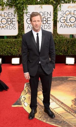 12.jan.2014 - O ator Aaron Eckhart chega para a edição 2014 do Globo de Ouro, em Beverly Hills