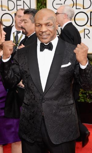 12.jan.2014 - O lutador Mike Tyson chega para a edição 2014 do Globo de Ouro, em Beverly Hills