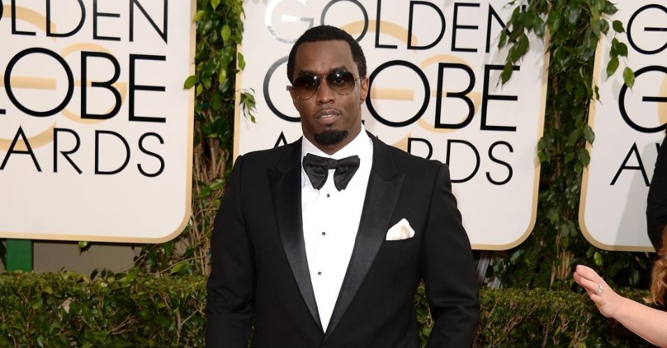 12.jan.2014 - O rapper Sean Combs, mais conhecido como P. Diddy, chega ao Globo de Ouro 2014, em Beverly Hills