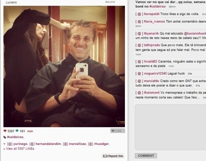 14.jan.2014 - O apresentador Luciano Huck corta o cabelo
