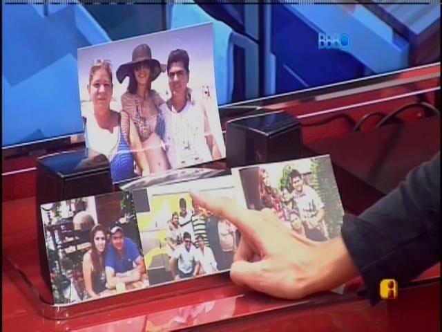 Letícia vê fotos dos familiares de Amanda, no quarto da líder.