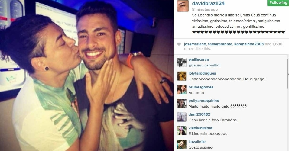 17.jan.2014- Cauã Reymond ganha beijo de David Brazil: