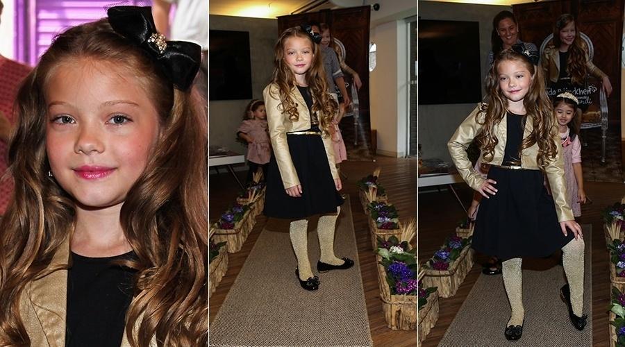 30.jan.2014 - Duda Bündchen, sobrinha de Gisele que está com 7 anos, está seguindo os passos da tia top model e participou, nesta quinta-feira (30), do lançamento da coleção de Inverno 2014 da grife Brandini que leva seu nome, na Vila Madalena, em São Paulo
