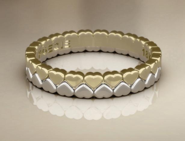 Aliança Hearts em ouro amarelo e branco 18k; da Poésie (www.poesie.com.br), por R$ 1.860 (unidade). Disponibilidade e preço pesquisados em fevereiro de 2014 e sujeitos a alteração