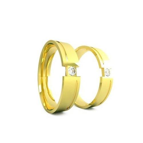 Aliança lisa em ouro 18k e um brilhante central; da Relojoaria A Suissa (www.asuissa.com.br), por R$ 5.502 (par). Disponibilidade e preço pesquisados em fevereiro de 2014 e sujeitos a alteração