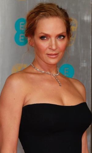 16.fev.2014 - Uma Thurman no tapete vermelho do BAFTA 2014. A premiação acontece no Royal Opera House, em Londres, na noite deste domingo (16)