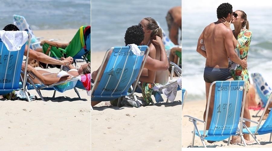 20.fev.2013 - Em dia de praia, Fred passa protetor na namorada