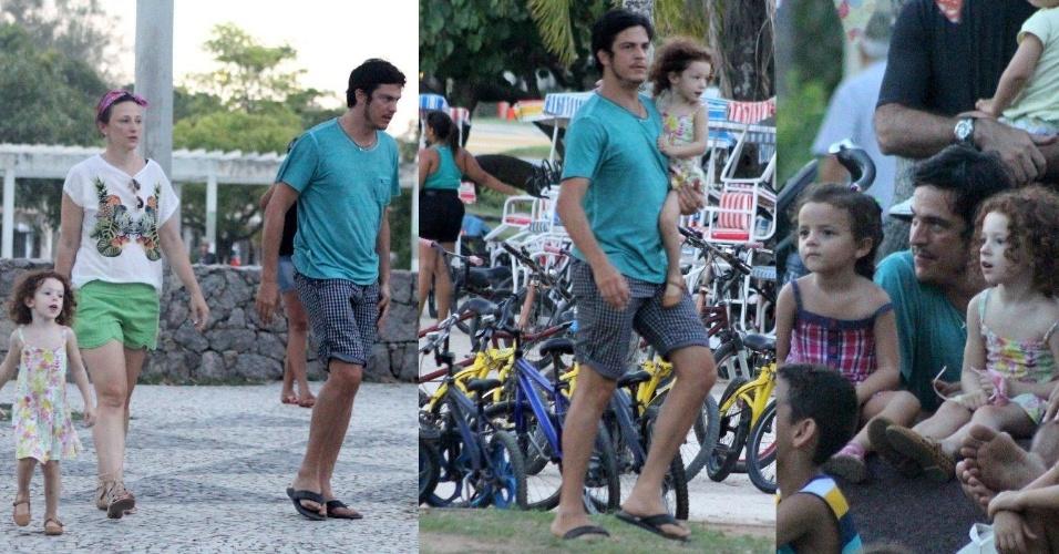 23.fev.2014- Mateus Solano é flagrado em momento de lazer com a mulher Paula Braun e a filha Flora na Lagoa Rodrigo de Freitas, zona sul do Rio