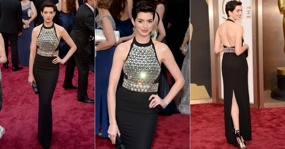 A atriz Anne Hathaway escolheu um longo Gucci com busto metalizado. A peça deixou as costas da atriz à mostra e trouxe fenda atrás