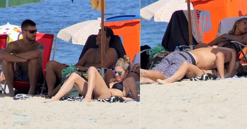 9.mar.2014 - O casal Rodrigo Hilbert e Fernanda Lima aproveitou o domingo de sol para ir à praia no Leblon, e acabaram trocando um beijo