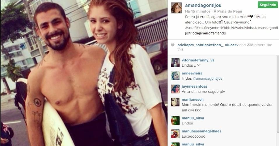 21.mar.2014 - Amanda posta foto ao lado do ator Cauã Reymond:
