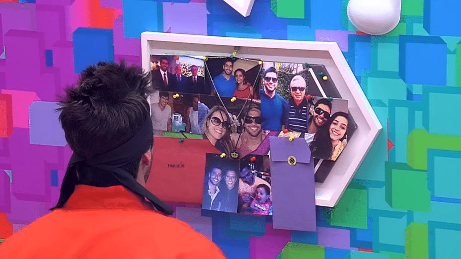 23.mar.2014 - Marcelo chora ao admirar fotos de seus familiares presas ao mural do quarto Festa. O brother se isolou durante todo o dia