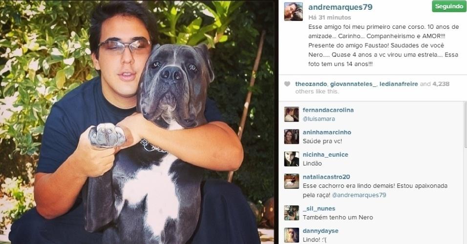 9.abr.2014 - André Marques postou uma foto em que aparece bem mais magro, tirada há 14 anos. Na companhia de um cachorro na imagem, o apresentador do