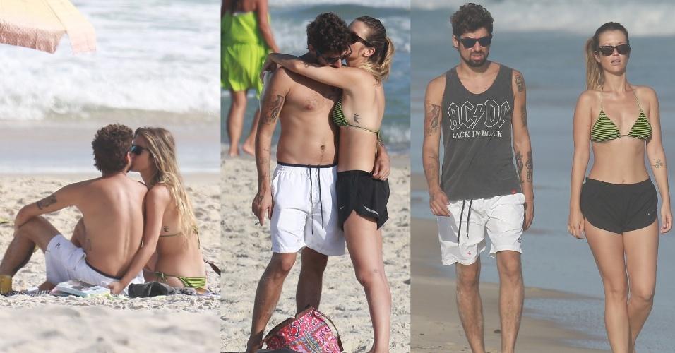 21.abr.2014- Juliana Didone aproveitou o feriado de Tiradentes para namorar na praia da Barra da Tijuca, no Rio de Janeiro. A atriz foi flagrada trocando beijos com o namorado, o artista plástico Flávio Rossi