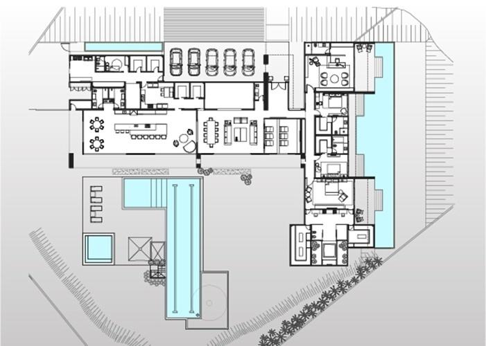 Em um terreno de 3.923 m², a Casa TB, assinada pelo escritório Aguirre Arquitetura, tem 880 m² de área construída. No desenho, é possível constatar generosos espaços como a varanda gourmet e o living, integrados a área verde e de lazer com piscina de 21 m de extensão