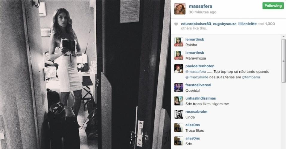 3.mai.2014 - Grazi Massafera acorda cedo e mostra foto com mala