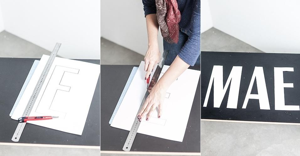 Com a palavra impressa no papel sulfite A3, recorte cada letra com a ajuda da régua e do estilete sobre a base de corte
