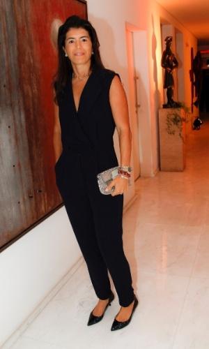 14.mai.2014 - Rossana Fittipaldi, mulher de Emerson Fittipaldi, vai ao aniversário do consultor de etiqueta Fábio Arruda em São Paulo
