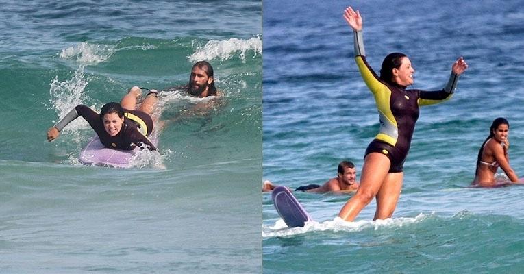 17.mai.2014 - Fabíula Nascimento aproveitou o sábado para aprender a surfar com os amigos na praia da Barra da Tijuca, na zona oeste do Rio de Janeiro. Depois de conseguir pegar uma onda, a atriz não se segurou na prancha e acabou caindo no mar