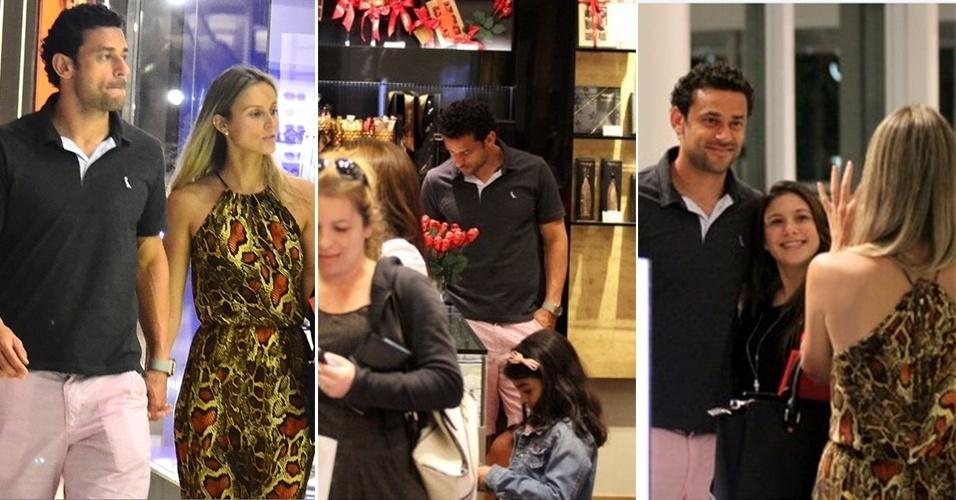 7.jun.2014 - O jogador da Seleção Brasileira de futebol, Fred, com a namorada, a publicitária Paula Armani, em um shopping do Rio de Janeiro