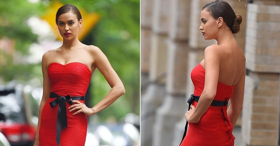 10.jun.2014 -  Irina Shayk participa de um ensaio fotográfico em Nova York e é flagrada com alfinetes na parte de trás do vestido vermelho