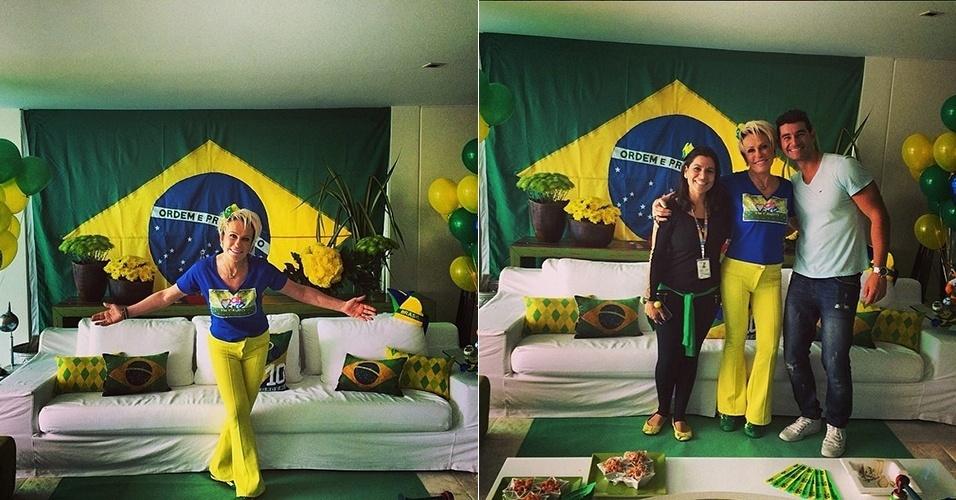 """Ana Maria Braga mostrou a decoração de sua casa para a Copa do Mundo, que ganhou bexigas verdes e amarelas, almofadas personalizadas e uma enorme bandeira do Brasil. """"Eles são os responsáveis pela decoração linda aqui na minha casa @crissanti39 @franklinaglio. Vai Brasil"""", vibrou a apresentadora"""