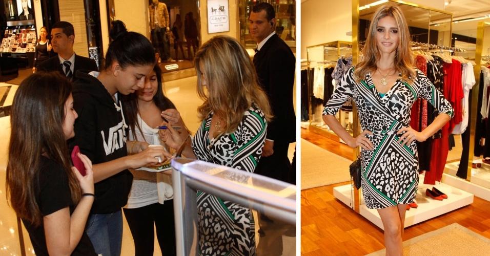 13.jun.2014 - Fernanda Lima atende aos fãs em frente a uma loja no shopping JK Iguatemi, na zona sul de São Paulo