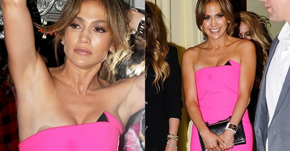 17.jun.2014 - Jennifer Lopez foi clicada saindo de restaurante com amigos e familiares. De vestido rosa, ao levantar o braço,  deixou à mostra adesivos protetores de seios