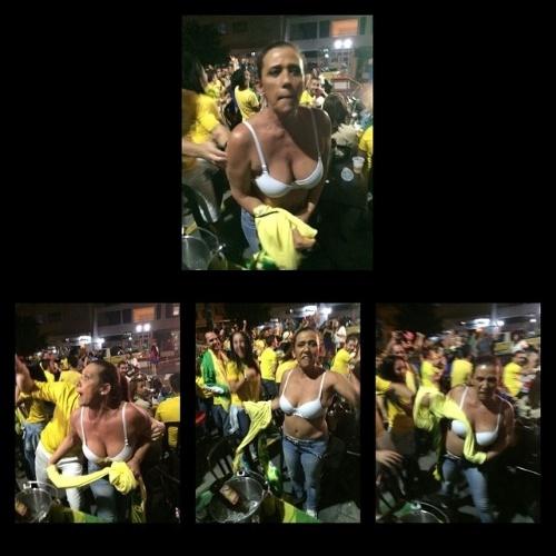 24.jun.2014 - Rita Cadillac tira a roupa para comemorar o gol de Fred no jogo entre Brasil e Camarões
