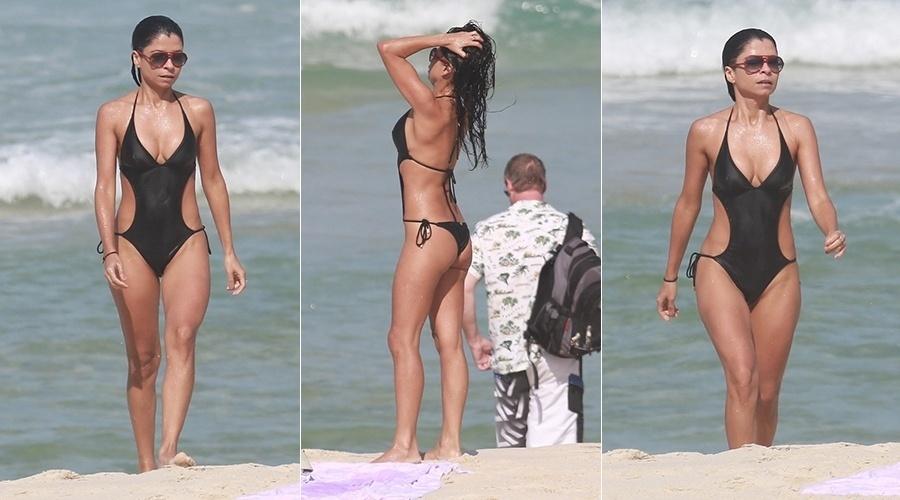 27.jun2014 - Ana Lima aproveita manhã ensolarada para mergulhar em praia do Rio