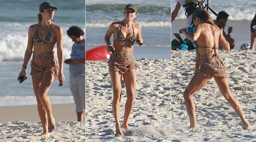 6.jul.2014 - Grazi Massafera faz exercícios na areia da praia da Barra