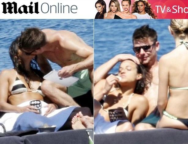 5.jul.2014 - Zac Efron e Michelle Rodriguez se beijam e trocam carinhos em iate