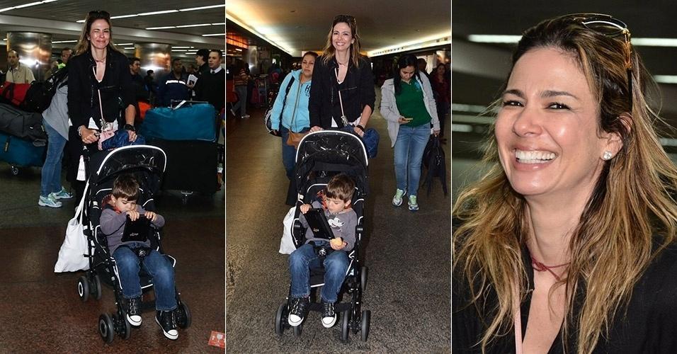 28.jul.2014 - Luciana Gimenez desembarcou no Aeroporto Internacional de Guarulhos, em São Paulo, com o filho Lorenzo