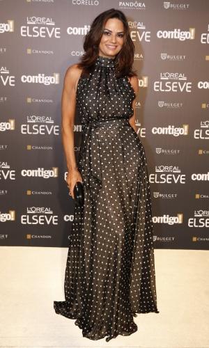 28.jul.2014 - Luiza Brunet usa um longo de bolinhas na 16ª edição do Prêmio Contigo! de TV, realizado no hotel Copacabana Palace, no Rio