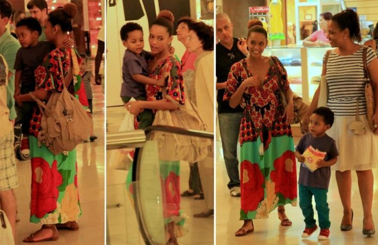 25.ago.2014 - Grávida de quatro meses, Taís Araujo carrega o filho, João Vicente, de três anos, em um passeio pelo shopping da Gávea, na zona sul do Rio de Janeiro, nesta segunda-feira