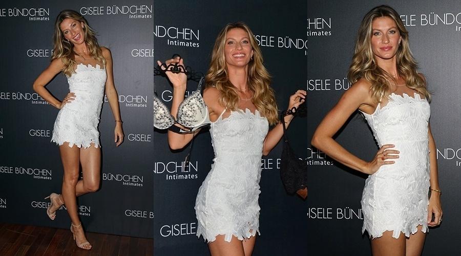 26.ago.2014 - De vestidinho branco, Gisele Bündchen participa de lançamento de sua marca de lingeries em São Paulo