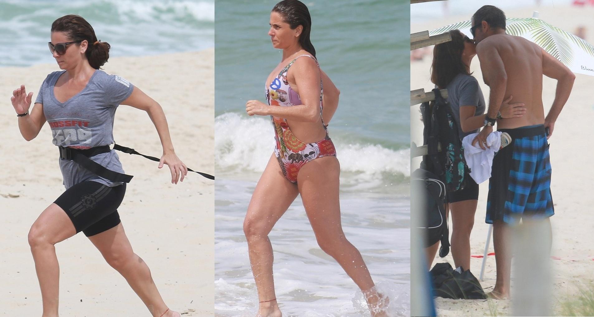 1.set.2014 - Após treino funcional e mergulho no mar, Giovanna Antonelli é flagrada em clima de romance com o marido na praia da Barra da Tijuca, zona oeste do Rio