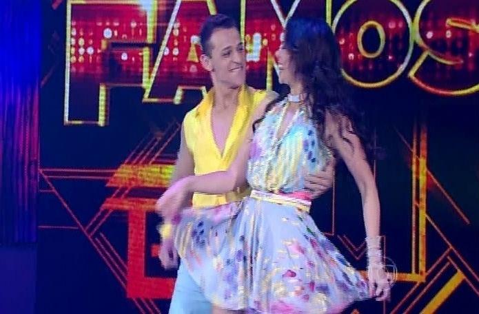 """14.set.2014 - Deny Ronaldo e Vanessa Gerbelli dançam """"Dançando Lambada"""" de Kaoma na """"Dança dos Famosos"""" durante a repescagem da lambada"""