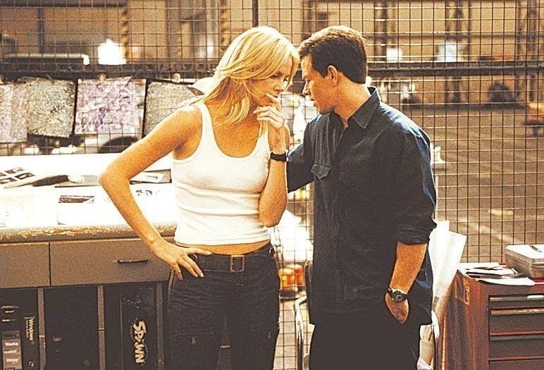 """Cena do filme """"Uma saída de mestre"""", com Charlize Theron e Mark Wahlberg"""