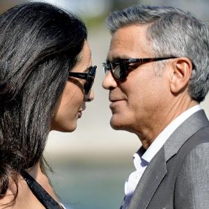 26.set.2014 - George Clooney e Amal Alamuddin em Veneza. Os dois se casarão neste sábado na cidade italiana - AFP PHOTO / ANDREAS SOLARO
