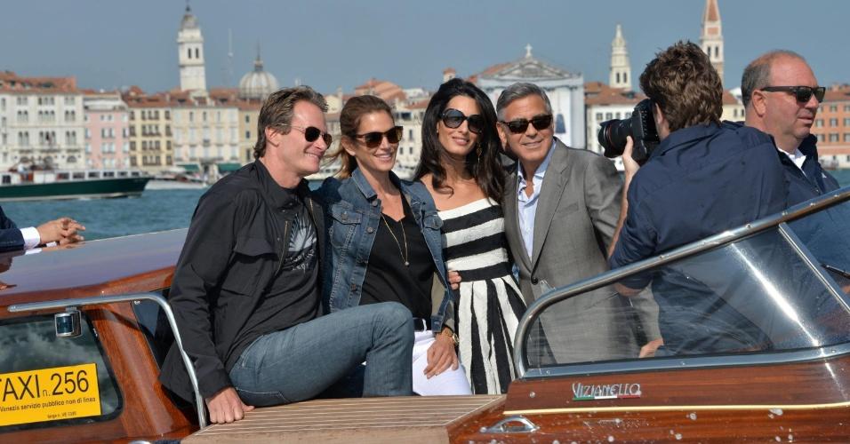26.set.2014 - George Clooney e Amal Alamuddin chegam em Veneza, na Itália, acompanhados da modelo Cindy Crawford e seu marido, Rande Gerber. Clooney e Amal se casarão neste sábado e Gerber será o padrinho do ator