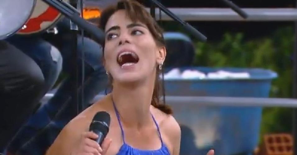 """8.out.2014 - Heloisa Faissol canta funk junto com o grupo Molejo durante churrasco em """"A Fazenda 7"""""""