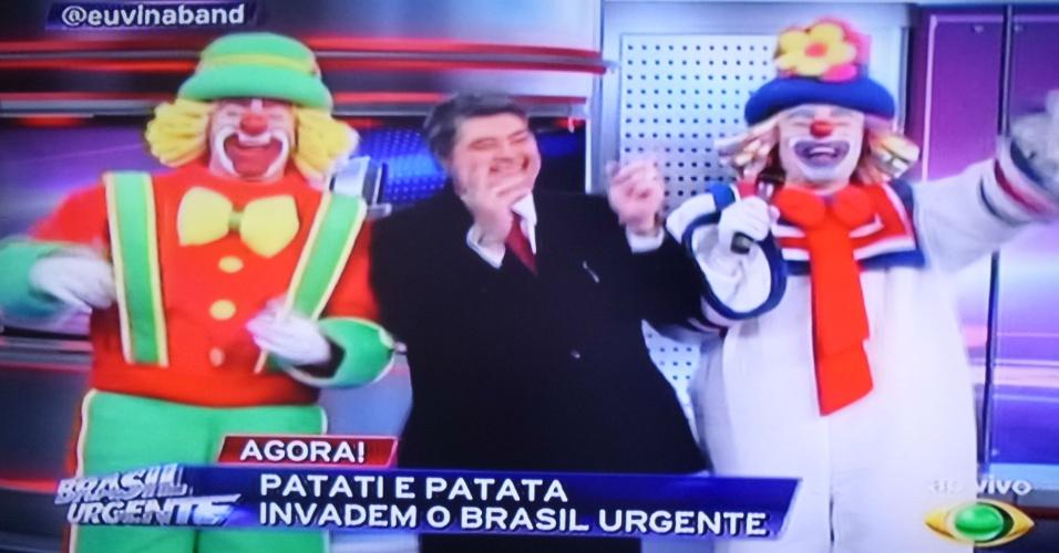 10.out.2014 - Datena dança e imita SIlvio Santos ao lado de Patati e Patatá no